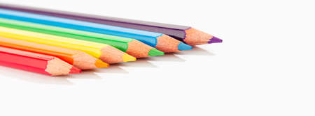 Color pencils isolated on white background. Rainbow flag LGBTQ Colored pencils. Copy space