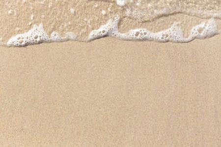 Beach Sand with sea foam waves