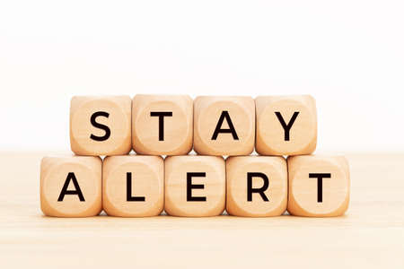 Stay alert concept. Wooden blocks with text on table. Copy space Stock fotó