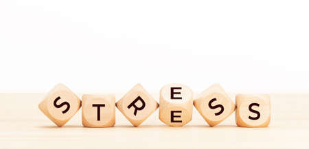 Stress concept. Wooden blocks with word on table. Copy space
