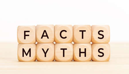 Facts Myths concept. Wooden blocks with text on table. White background. Copy space