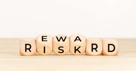 Risk Reward concept. Wooden block with text on table. Copy space Stock fotó
