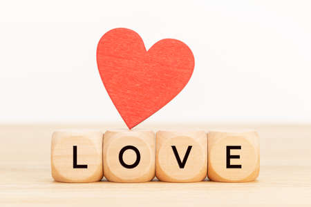 Love concept. Wooden blocks with text and wooden shaped heart on table. Copy space Stock fotó
