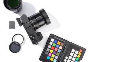 Flat lay of digital photographic equipment isolated on white background. Photography concept. Top view. Copy space