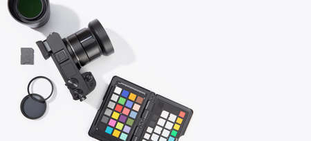 Banner of digital photographic equipment on white table with copy space. Photography concept background. Top view