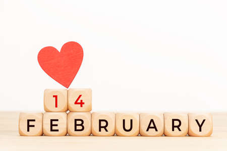 14 february text on wooden blocks and heart shaped on table. Valentines day concept. Copy space