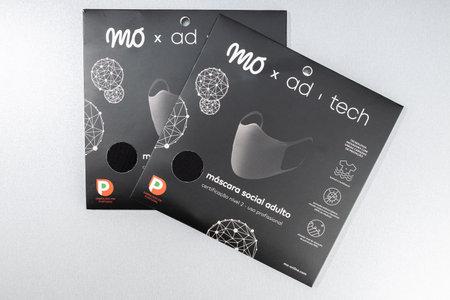 Galicia, Spain; october 30 2020: MO Ad-tech Face mask on table. Top view Sajtókép