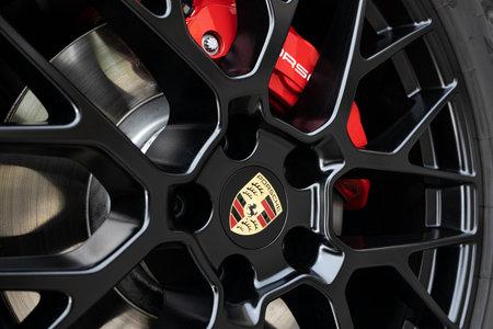 Galicia, Spain. October 30 2020: Black Wheel rim and red brake caliper of a Porsche car