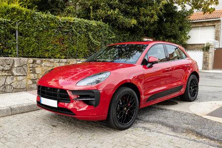 Galicia, Spain. October 30 2020: Red Porsche Cayenne GTS car on street Sajtókép