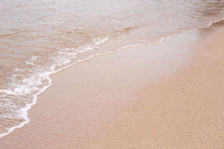 Soft beautiful sea wave on sandy beach. Background texture. Wet Sandy beach Stock fotó