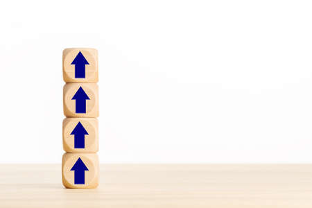Business growth process concept. Pile of wooden blocks with Arrow pointing up. Copy space Stock fotó