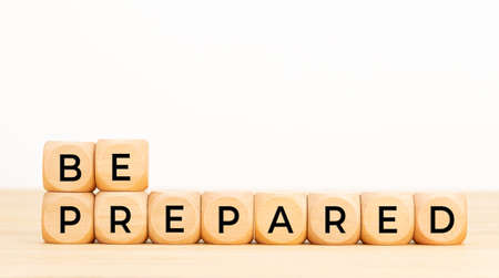 Be prepared phrase in wooden blocks on table. White background. Copy space Stock fotó