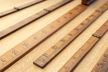 Group of Old wooden ruler on table. Measuring or accuracy concept. Close up Stock fotó