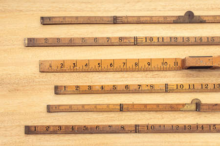 Group of Old wooden ruler on table. Measuring or accuracy concept. Top view