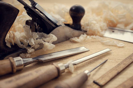 Carpentry tools and wood shavings on table. Woodworking, craftsmanship and handwork concept Stock fotó