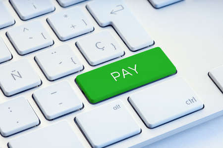 Pay Word on green Keyboard Key Stock fotó