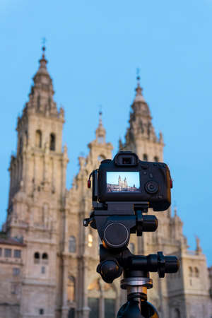 DSLR photo camera with digital display showing the Santiago de Compostela cathedral at dusk. Touristic point photography of Galicia, Spain. Copy space Stock fotó