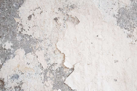 Old Wall damaged with blown Plaster and paint clog, peeling paint damage, water damage on building wall. Grunge abstract background Stock fotó