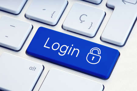 Login Word and lockpad on blue computer Keyboard Key. Technology security or hacking concept Stock fotó