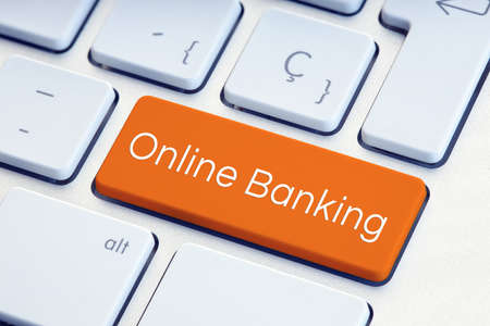 Online Banking Word on orange color computer Keyboard Key Reklamní fotografie