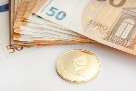 Ethereum coin and Euro banknotes. Blockchain money versus fiat money concept 版權商用圖片