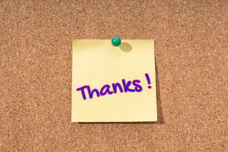 Thanks word on yellow note on cork board