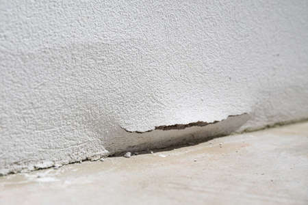 Outdoor wall damaged with crack caused by water and damp. Water leakage
