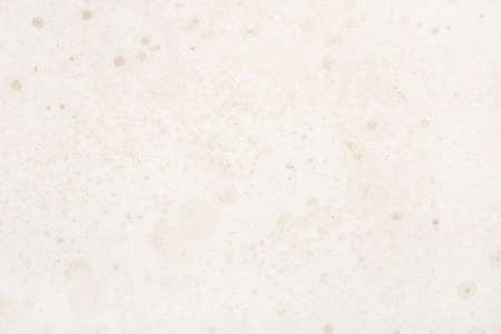 Old and dirty paper background with stains and humidity effects