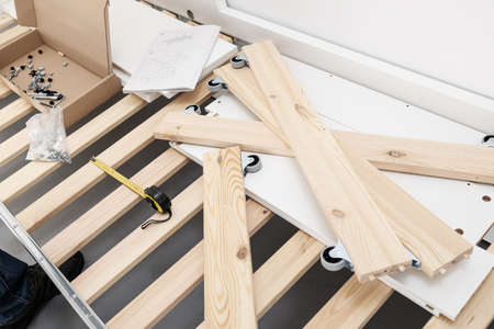 View of a bed being assembled. Furniture assembly