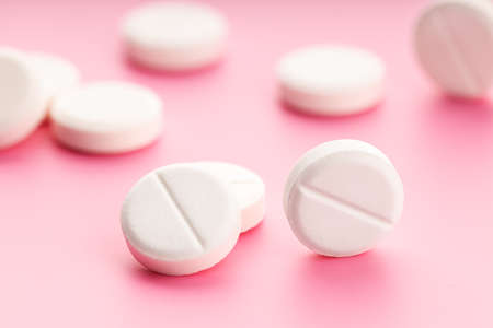 Group of Medicine pills on pink background. Medicine, healthcare and pharmacy concept