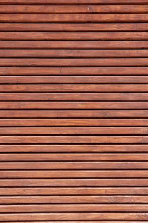Wood paneling background texture. Horizontal Decorative Wood plank Pattern on building facade 版權商用圖片