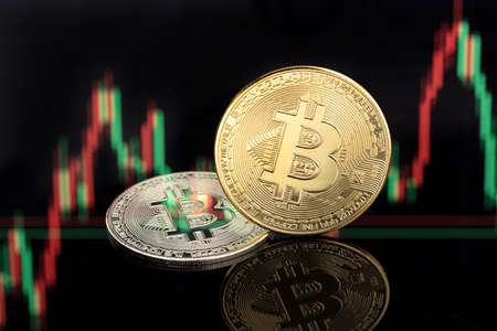 Bitcoin coins on stock chart background. Cryptocurrency blockchain money. Copy space