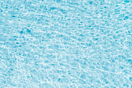 Swimming pool water surface background. Turquoise, bright and rippled water surface texture 版權商用圖片