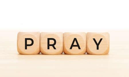 Pray word on wooden blocks. White background. Copy space 版權商用圖片