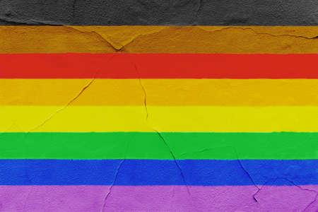 New pride flag painted on grunge Cracked wall. LGBTQ gay Grunge texture background 版權商用圖片