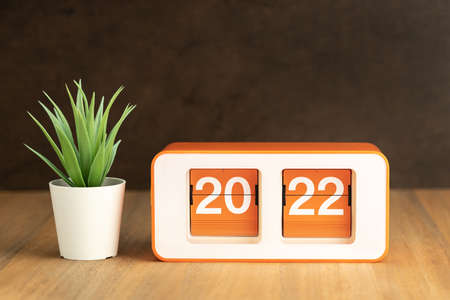 Retro Flip clock with 2022 number on wooden table. New year concept. Copy space