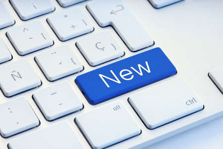 New word on blue computer Keyboard Key 版權商用圖片