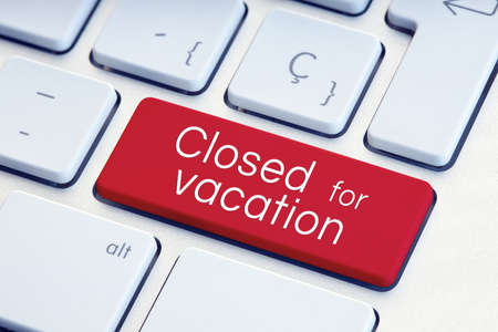 Closed for vacation phrase on computer Keyboard Key