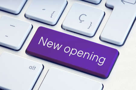 New opening phrase on purple computer Keyboard Key 版權商用圖片