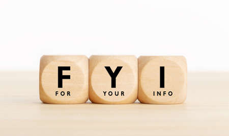 FYI or for your information text on wooden blocks. Copy space