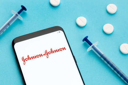 Galicia, Spain; June 8, 2020 : Johnson & Johnson logo on smart phone screen still life. Pharmaceutical company