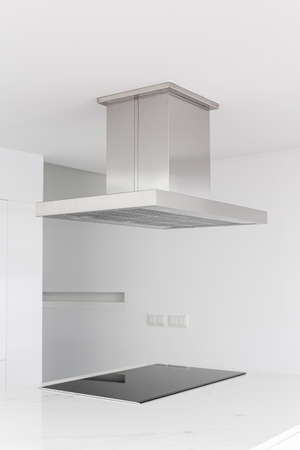 Cooker hood and electric stove of a modern and minimalist kitchen