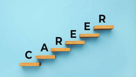 Career word on staircase on blue background. Increasing business, success process concept. Copy space