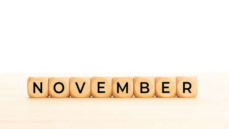 November word on wooden blocks. Copy space. White background