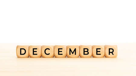 December word on wooden blocks. Copy space. White background
