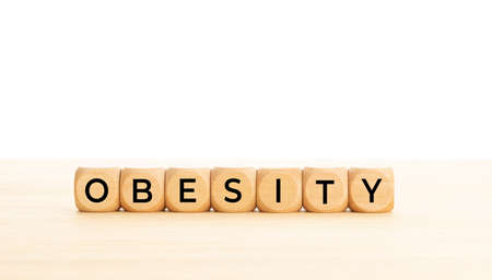 Obesity word on wooden block. Copy space. White background