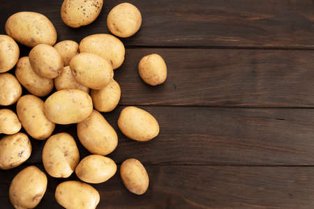 Group of New potatoes on wooden table. Top view. Copy space 版權商用圖片
