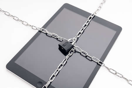 Security on digital tablet. Chain and padlock on tablet. Cyber security on digital devices concept