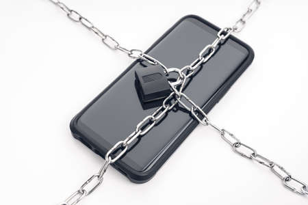Security on smartphone, chain and padlock on smart phone. Cyber security on digital devices concept 版權商用圖片