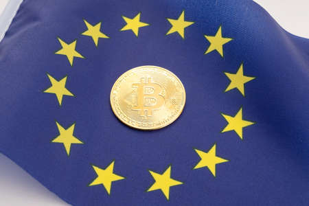 Bitcoin coin on European Union flag. Cryptocurrency on Europe